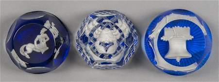 Three Baccarat sulphide paperweights, to include