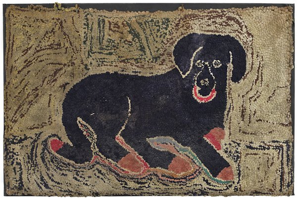 New England hooked rug of a recumbent dog with