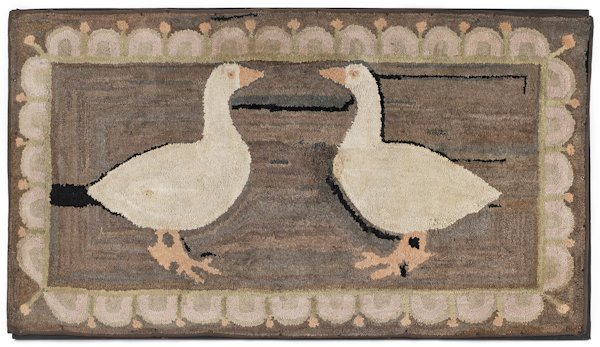 Hooked rug of two geese, 20th c., with a swag b