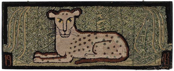 Hooked rug of a recumbent leopard, dated 1943