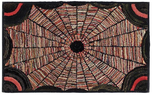Hooked rug of a variegated spider web, early 20t