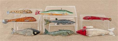 Eight carved and painted fish decoys, mid 20th c