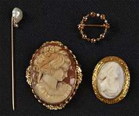 Three 14K yellow gold pins to include two with g