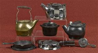 Miniature cast iron cooking items to include a G