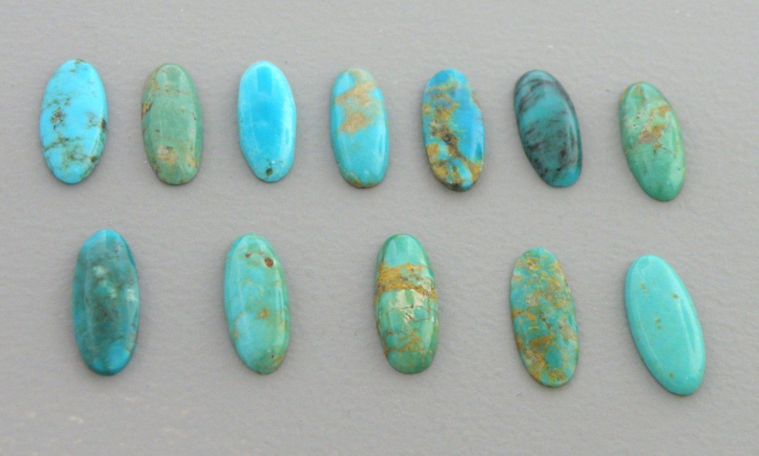 UNTREATED TURQUOISE OVAL/MARQUISE CABOCHON 21.58ct