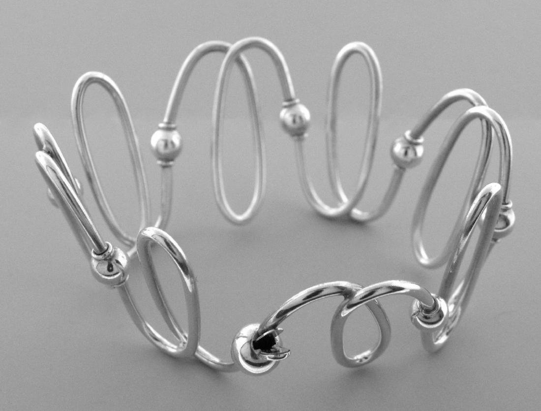 TIFFANY & Co. STERLING SILVER SPIRAL BANGLE BRACELET