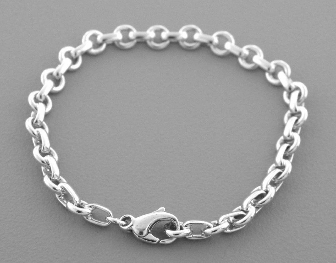 TIFFANY & Co. STERLING SILVER DONUT CHARM BRACELET