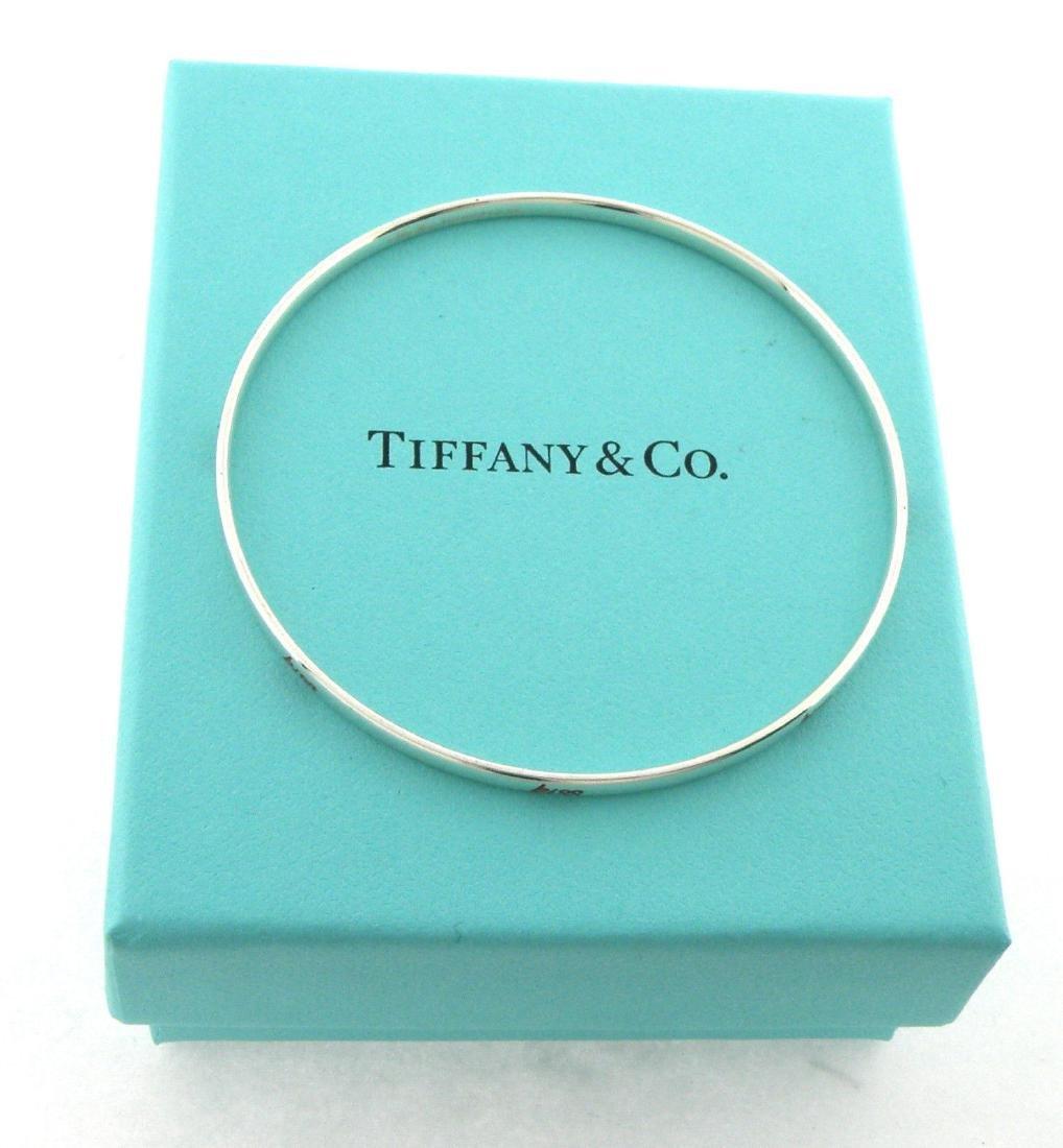 TIFFANY & Co. STERLING SILVER RED ENAMEL KISS BANGLE
