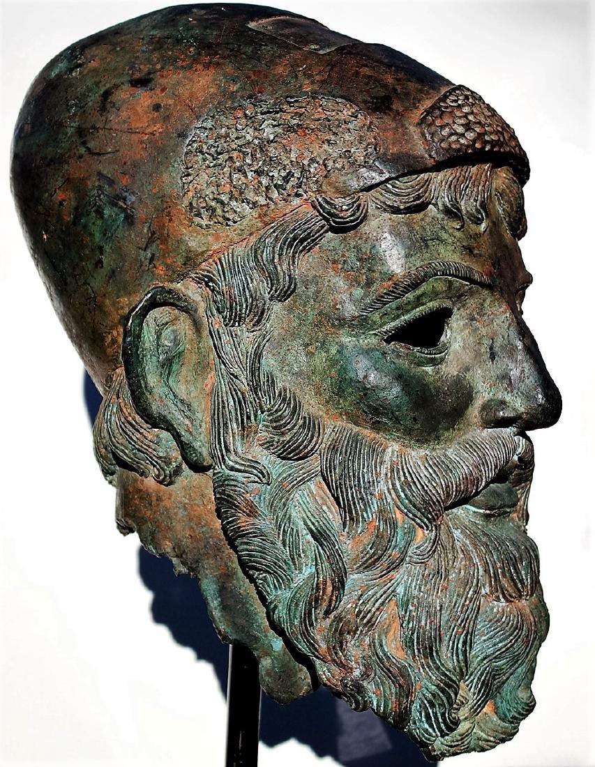 Classical bronze warrior wearing helmet