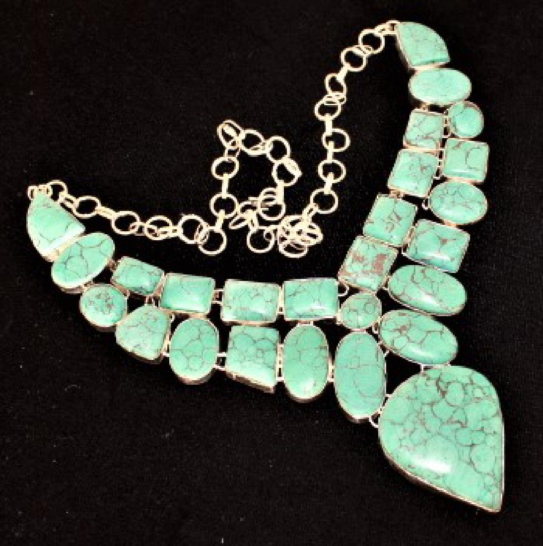 "Turquoise Silver Necklace Measures 18"" in length."