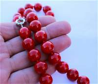 Natural red coral 14 mm. 18 inches in length.
