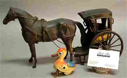 1017: Cast Iron Toy Horse and Carriage, with tin duck.