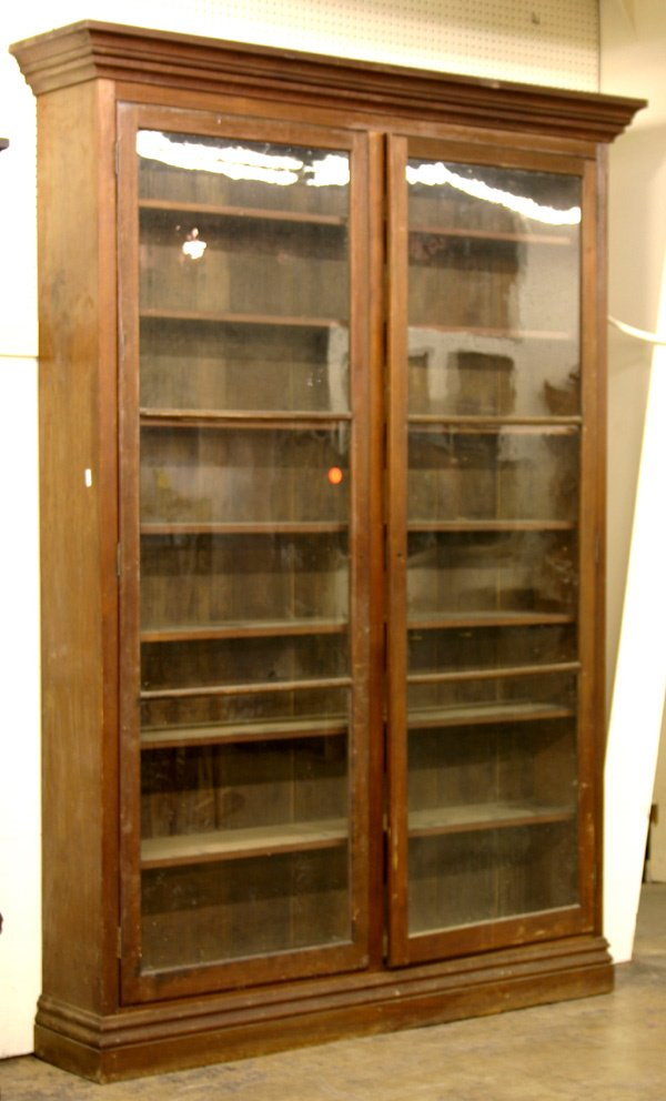 712A: LARGE 19TH CENTURY WALNUT BOOKCASE/CABINET.