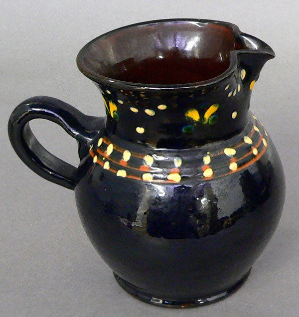 602: 19th C. Glazed and Enameled Redware Pitcher