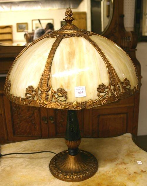 664: Antique Seven Panel Slag Glass Lamp.