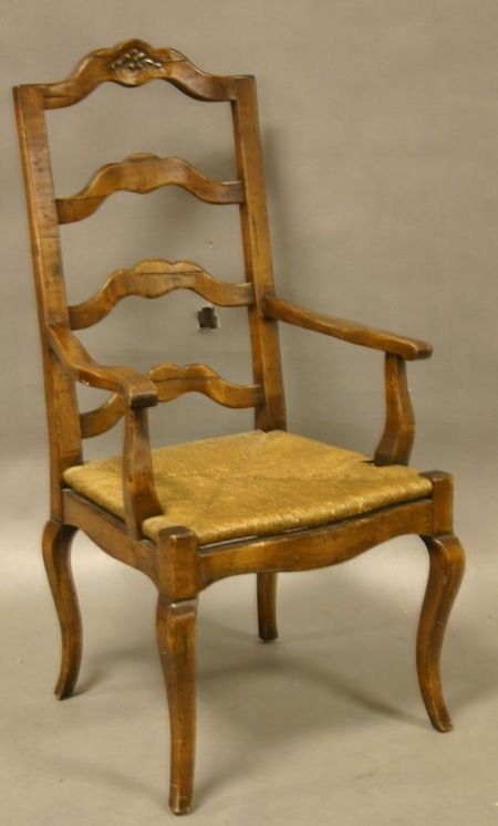 663: A Country French Fruitwood Arm Chair.