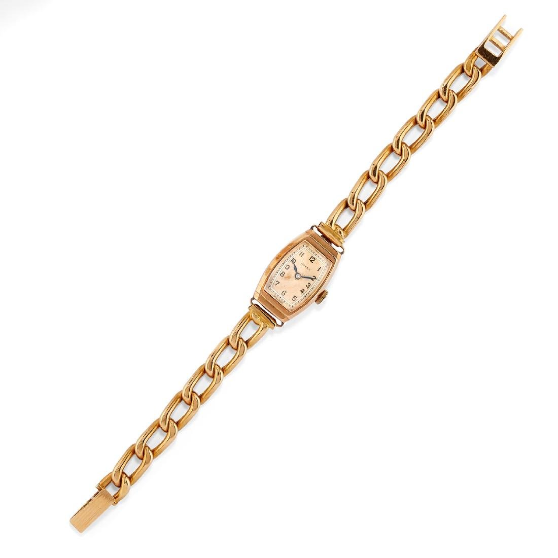 Rolex  - A 9K gold lady's wristwatch, Rolex