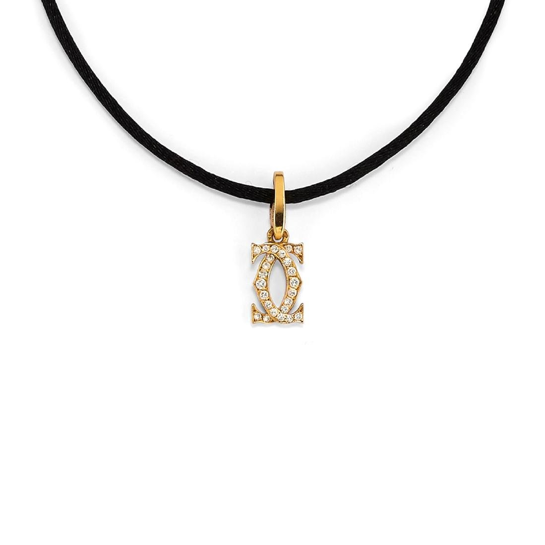 Cartier  - A 18K yellow gold and diamond pendant,