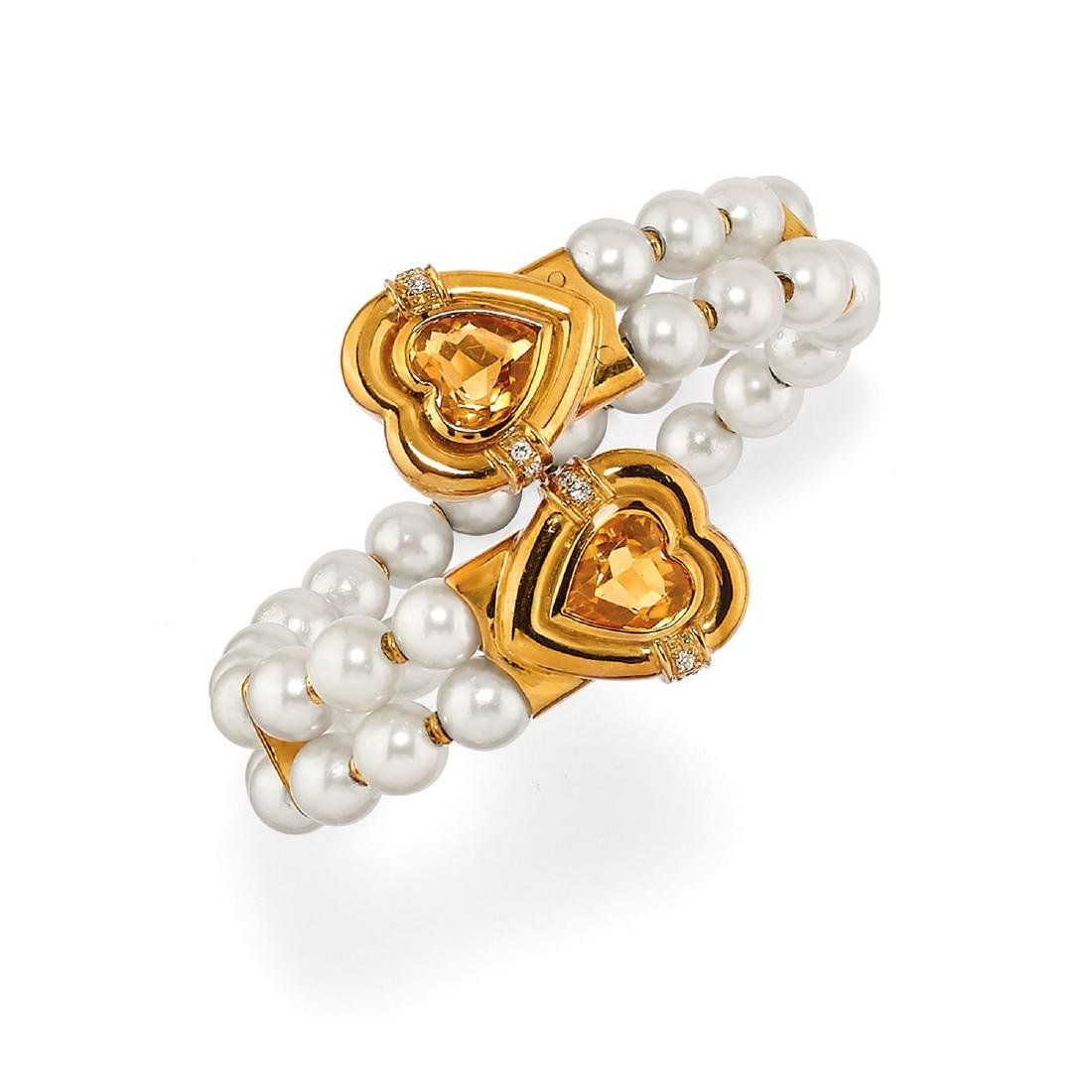 A 18K yellow gold, cultured pearl and diamond bangle