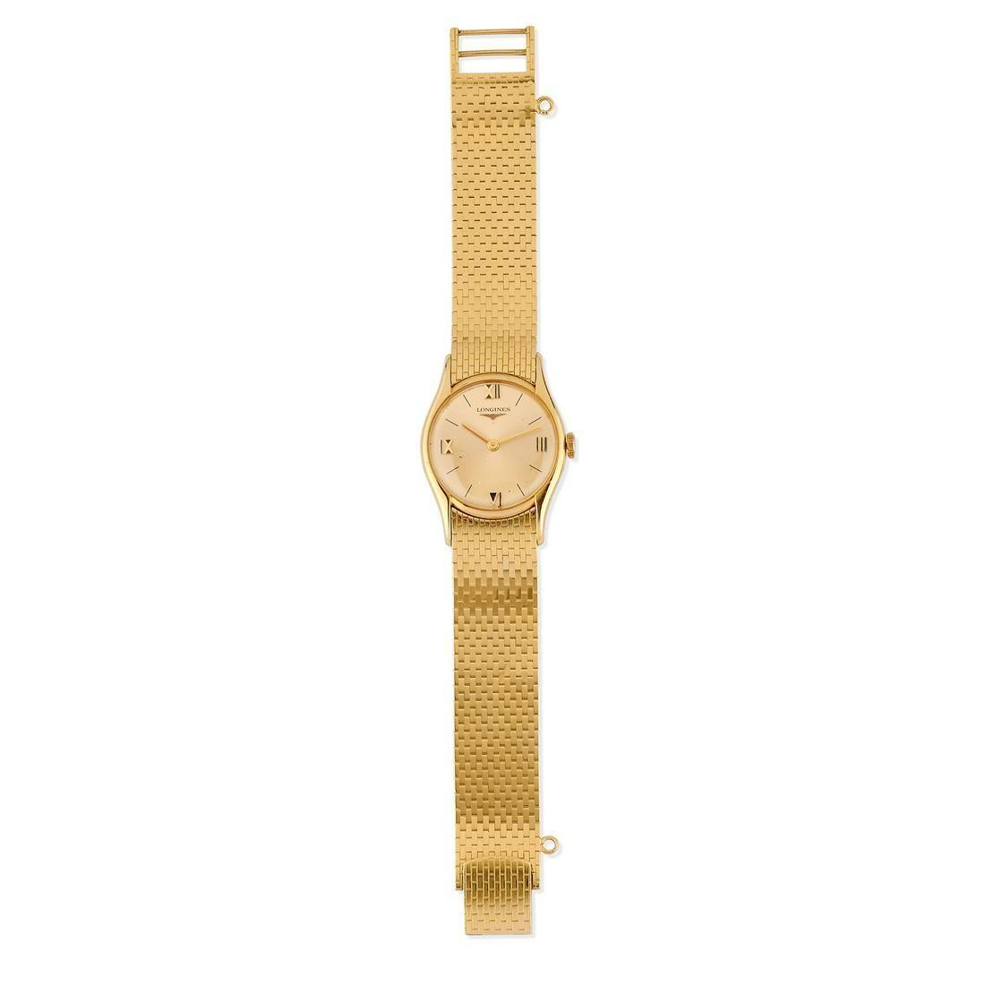 Longines - A 18K yellow gold wristwatch, Longines