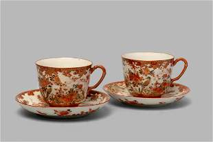 Pair of teacups and saucers in polychrome Kutani