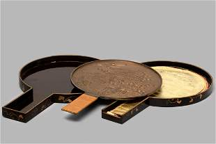 Bronze mirror with black lacquer case and gold