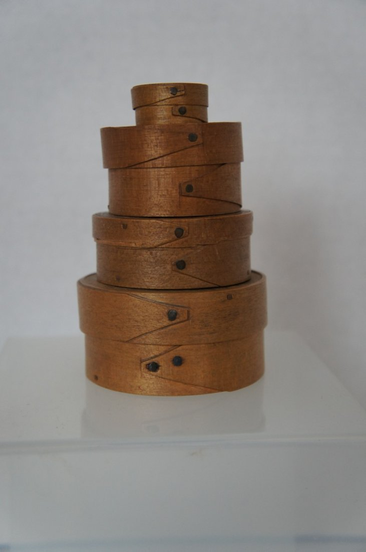 Stack of 4 tiny round opposing finger antique pantry