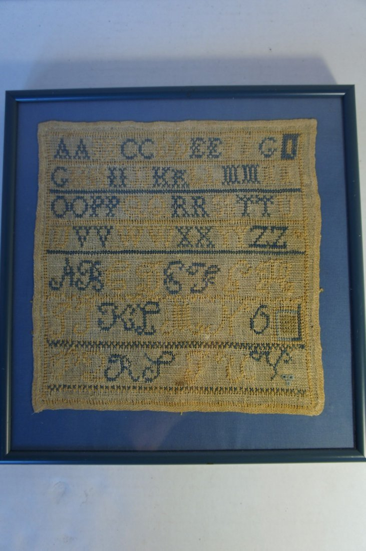 Small antique sampler in blues and yellows