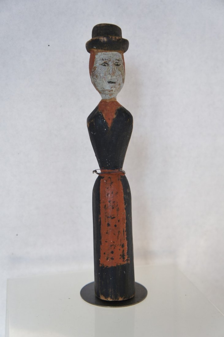 19th C. carved woman with hat, long skirt and apron