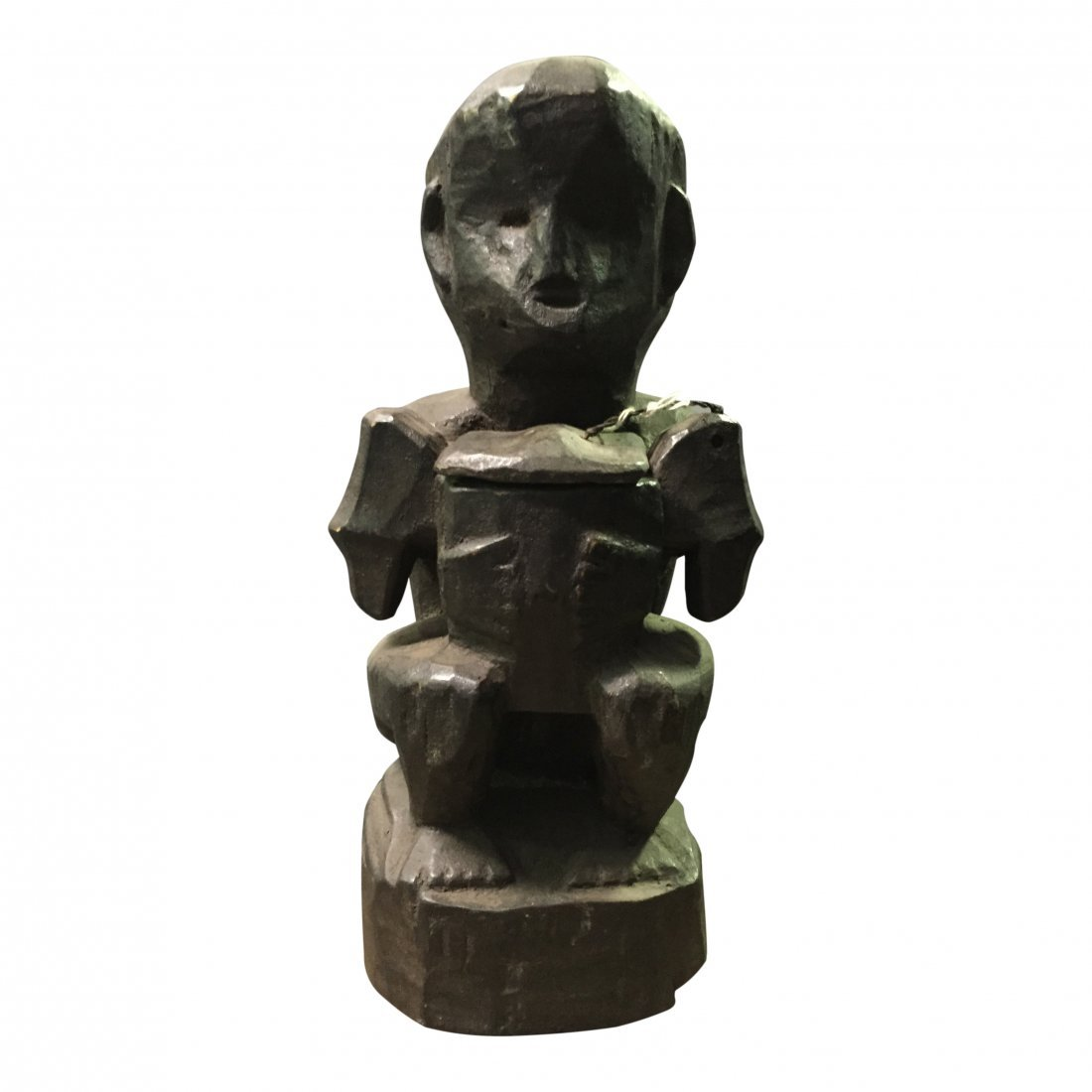 Bulul statue sitting and holding a food container