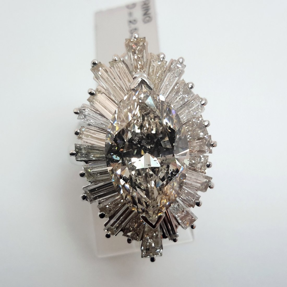 """""""PLATINUM MARQUISE/BAGG DIAMOND RING, An exceptional"""