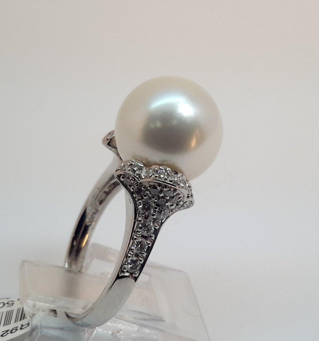 """PLATINUM DIAMOND & PEARL RING, This classic pearl ring"