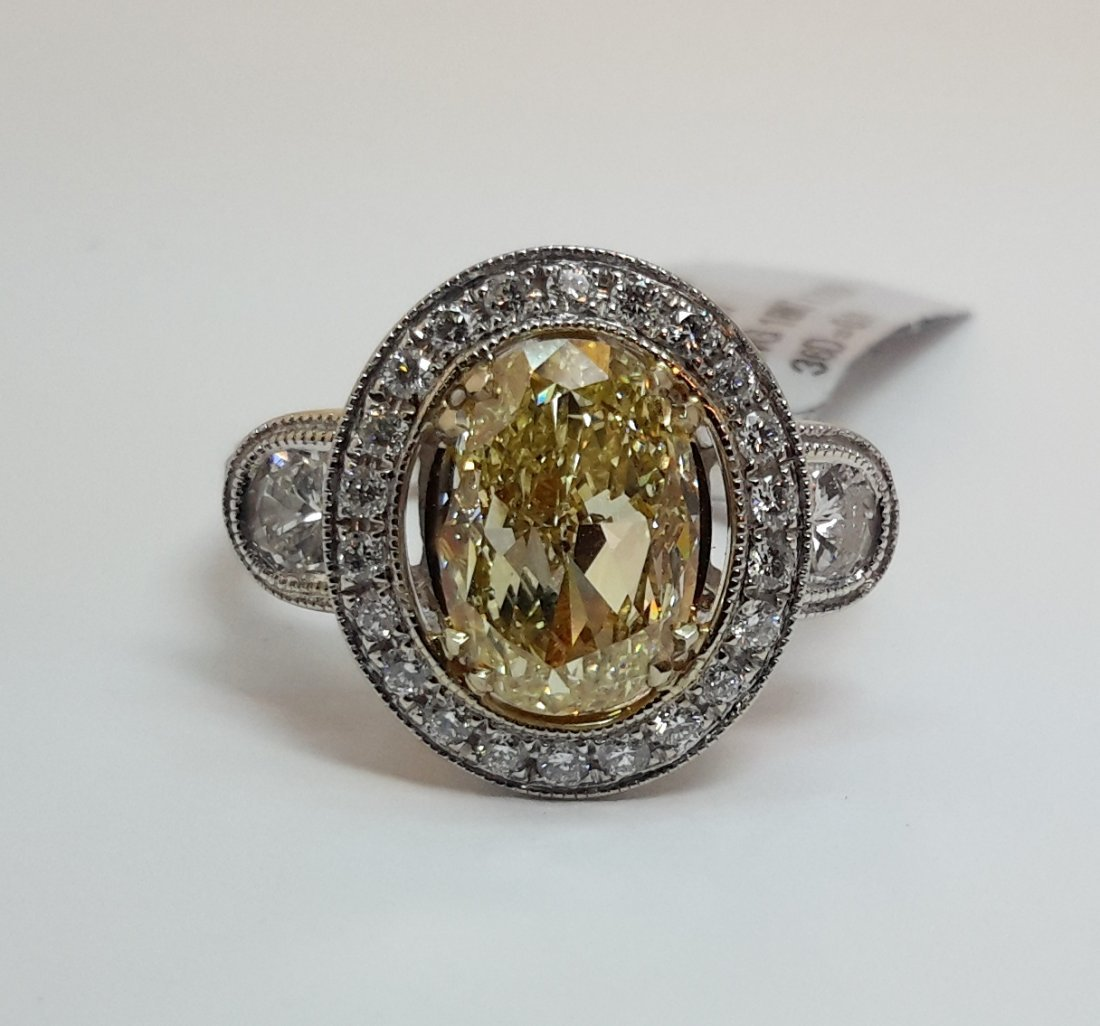 """18K W/G FANCY YELLOW DIAMOND RING, This precious ring"