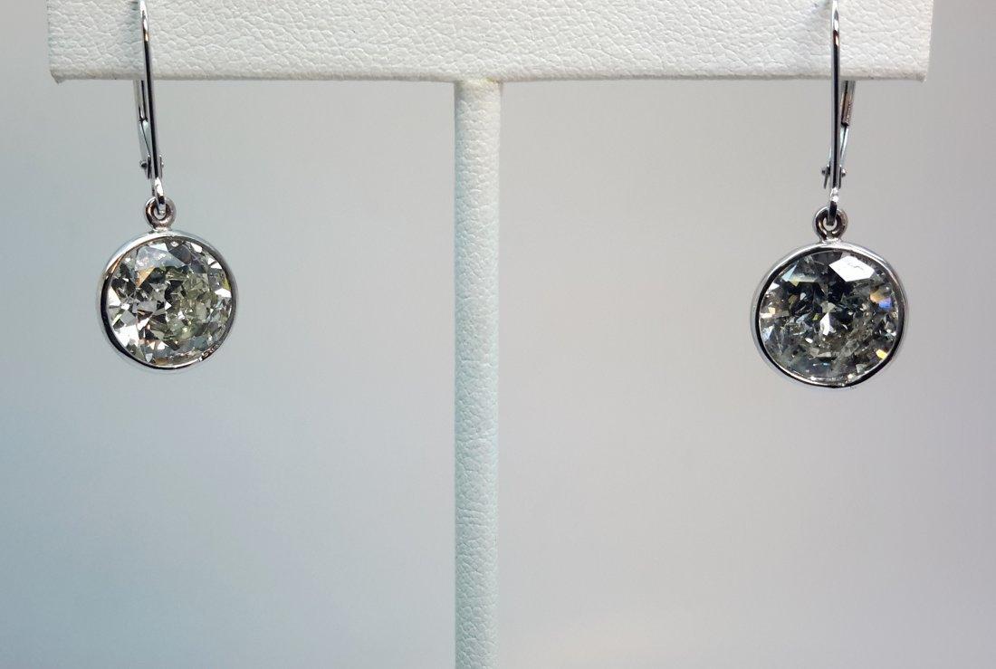 14K W/G DIAMOND EARRINGS Elegant diamond earrings in a
