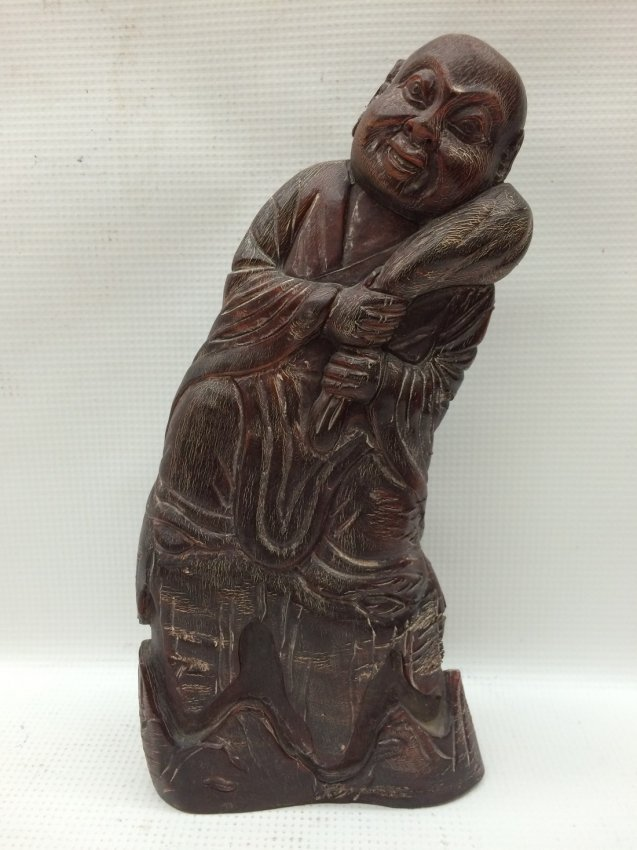 A Chinese Carved Horn Lohan