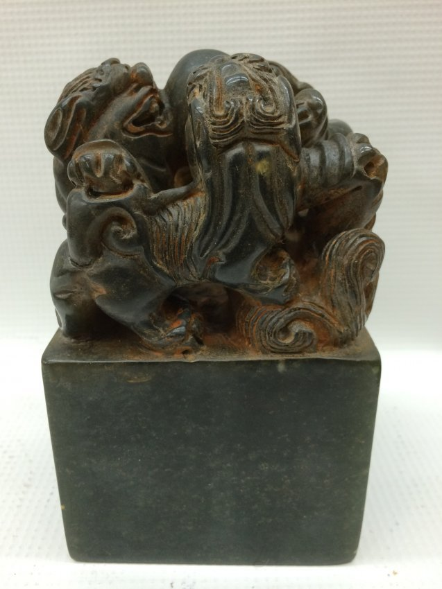 A Chinese Carved Green Soapstone Foo Dog Seal