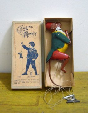 "Painted Tin ""climbing Monkey"" Toy"