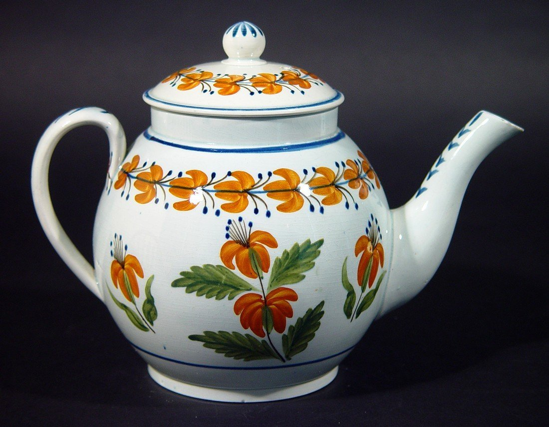 A Charming Prattware Teapot decorated with Orange