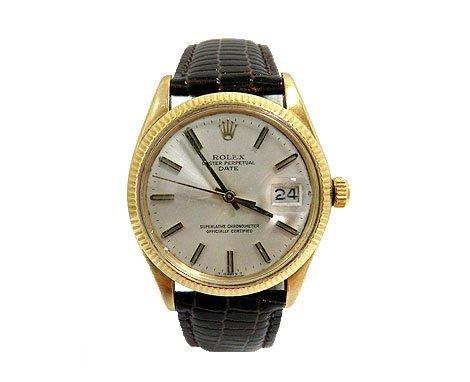 Rolex Oyster Perpetual Gold Bezel Watch