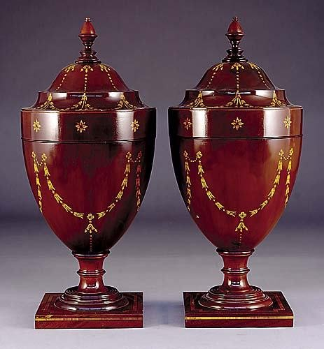 7: Pair carton-pierre knife urns