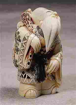 011: Japanese carved ivory okimono of immortal 20th ce