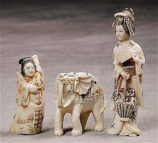 014: Three carved ivory figures 20th century