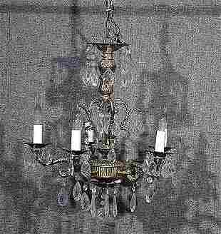Four gilt-metal and crystal chandeliers