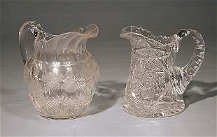 Two American cut-crystal beverage pitchers circa