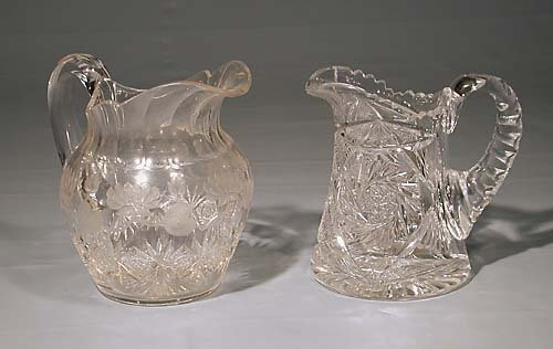 447: Two American cut-crystal beverage pitchers  circa