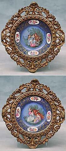 4: Pair of giltwood framed porcelain plates