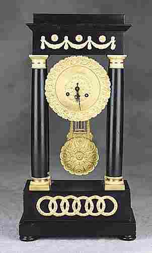 015: English gilt-bronze and ebony portico clock late 1