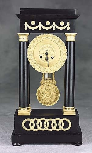 015: English gilt-bronze and ebony portico clock late 1