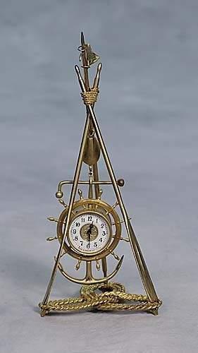 016A: Gilt-metal ship1s clock, by Ansonia Clock Co