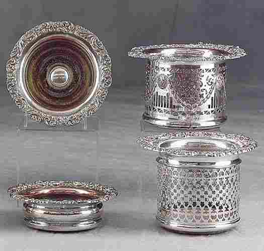 Four silverplate wine coasters